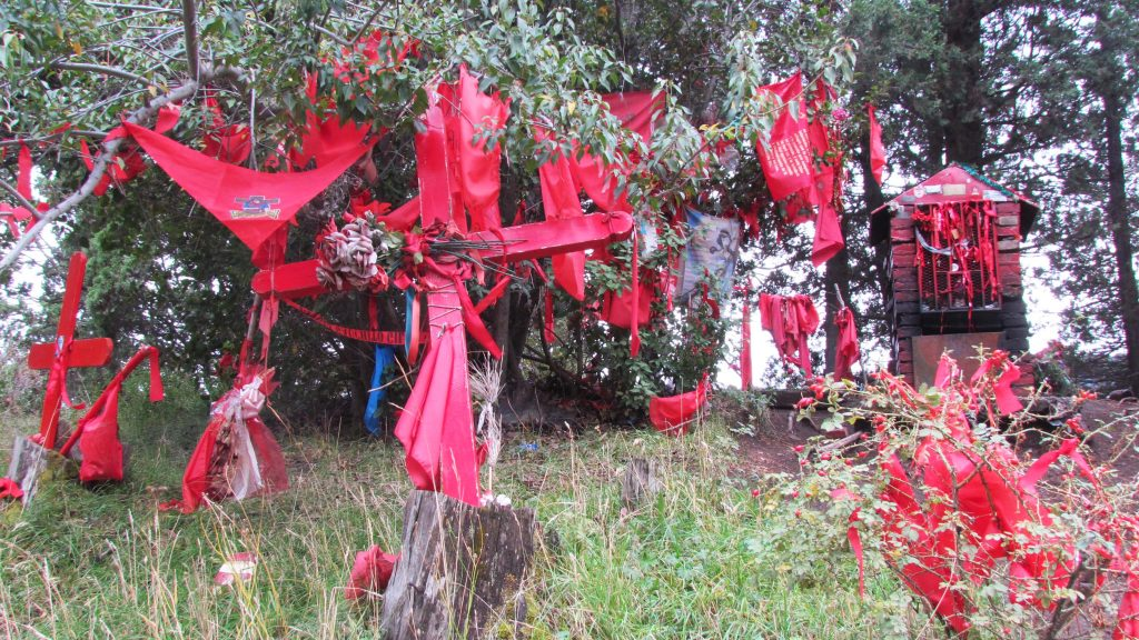 Flags surrounding a shrine near San Martin de los Andes, Argentina.