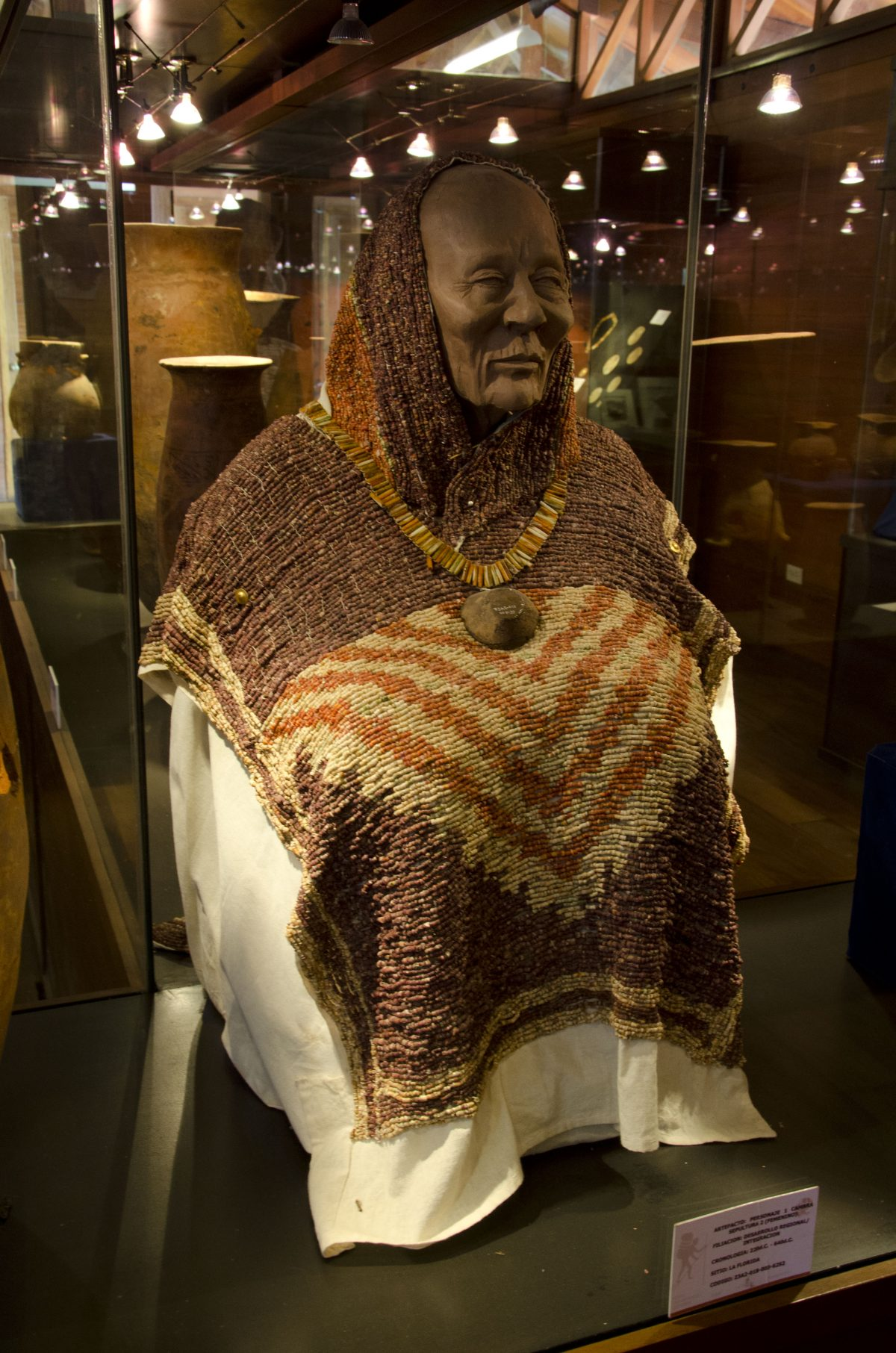 Front side of a beaded, shell poncho; La Florida Museum | ©Angela Drake