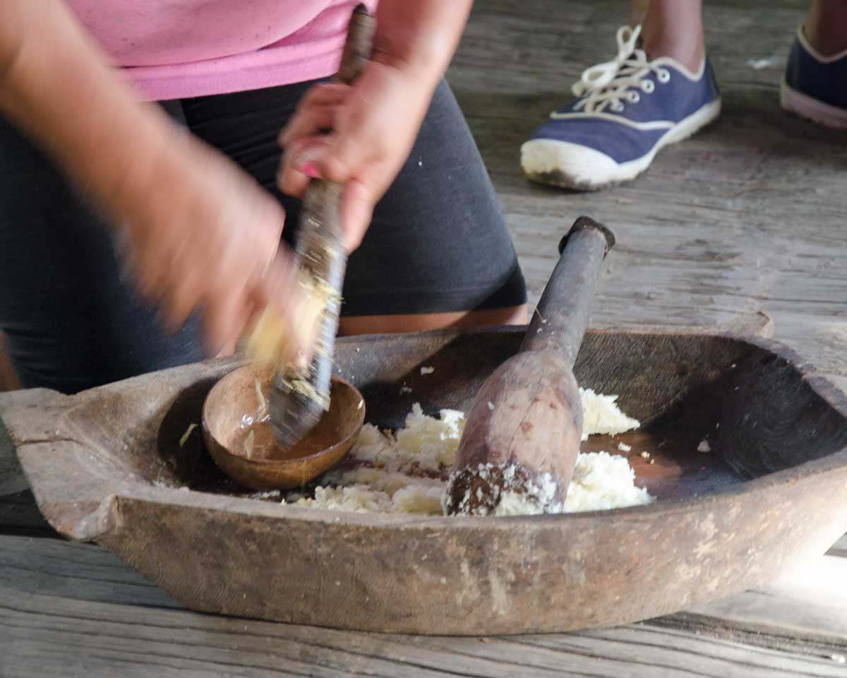 Grating sweet potato to start the Chicha de Yuca, Puerto Napo, Ecuador | ©Angela Drake