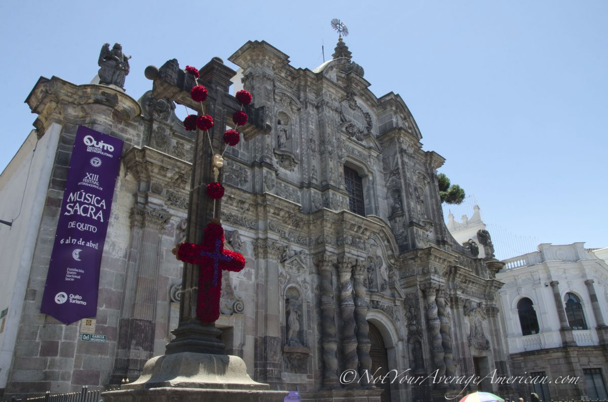 A rose rosary on the stone cross at the Compañia de Jesús | ©Angela Drake