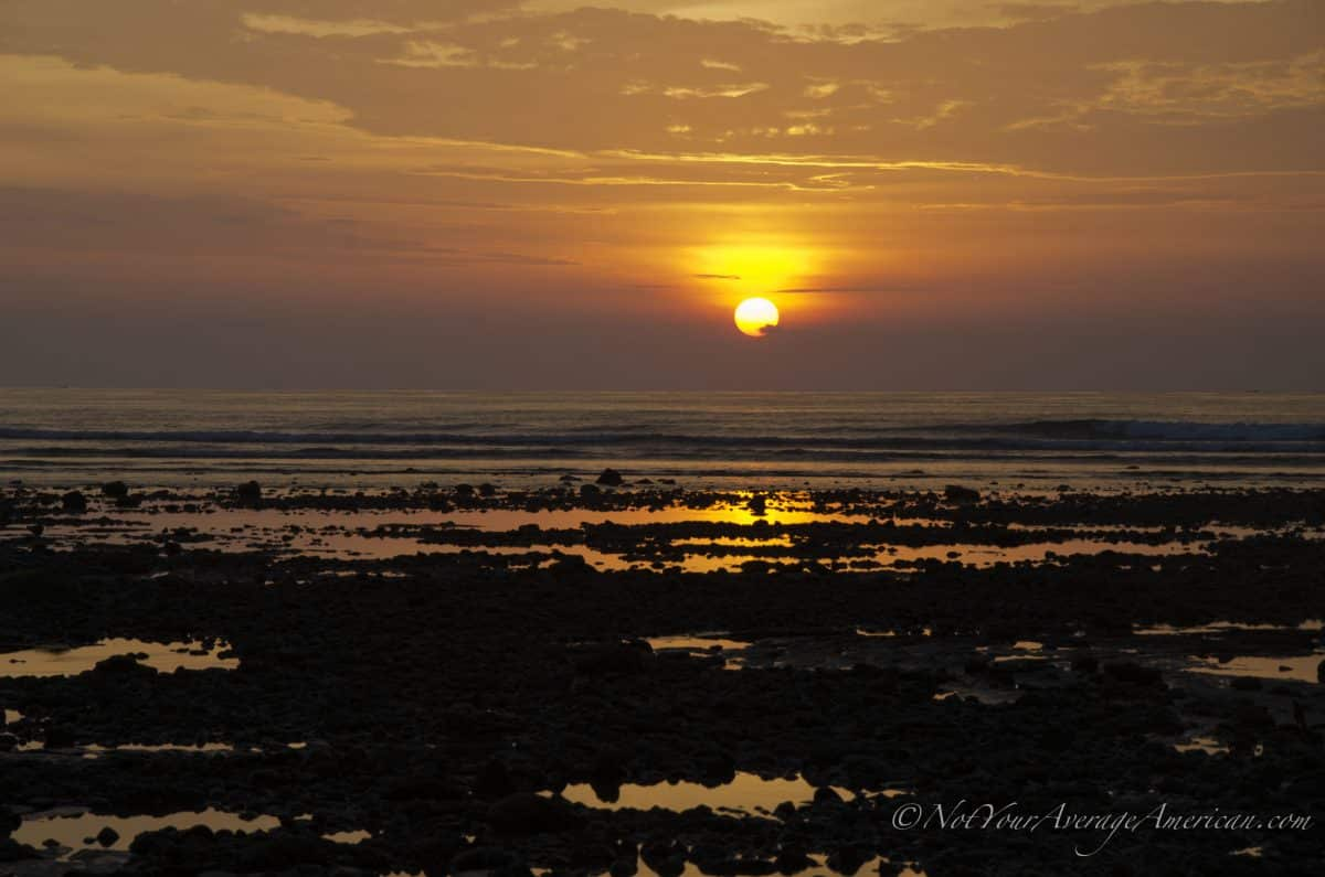 Sunset in front of the rocky beach in front of Chirije, Manabi, Ecuador | ©Angela Drake