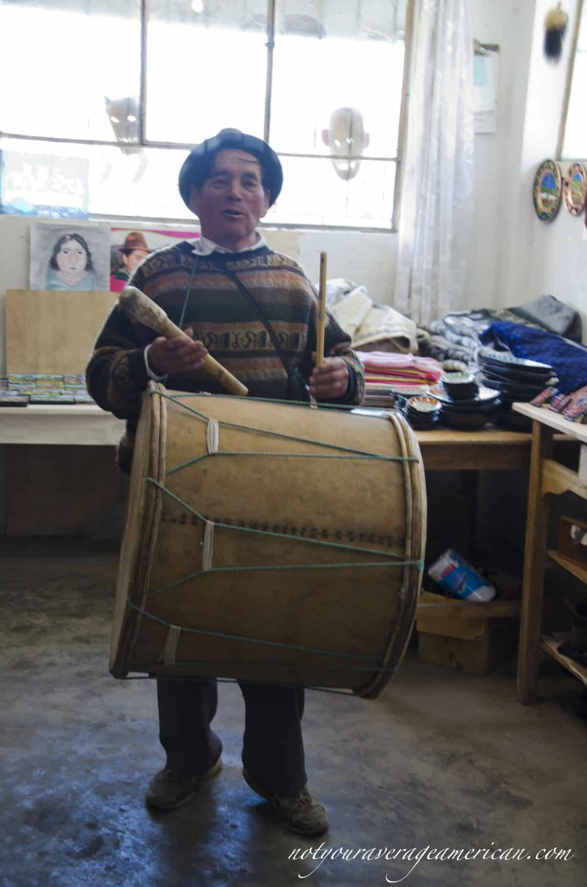 Julio Toaquiza with his drum and pipe.