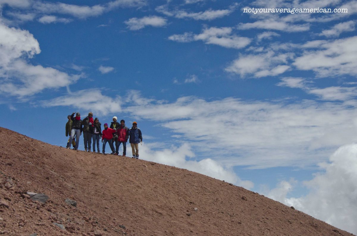 A group of Colombians proudly pose on a ridge, Cotopaxi National Park, Ecuador | ©Angela Drake