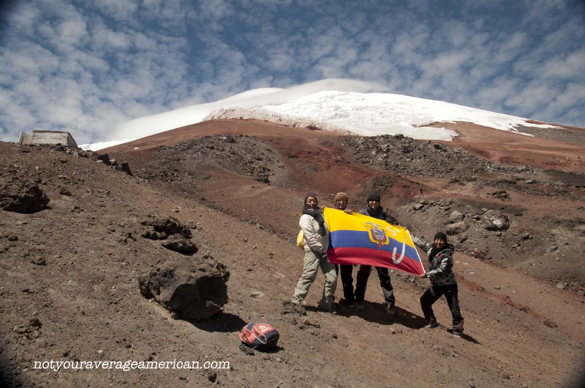 Quiteños & Author holding the Ecuadorian Flag, Cotopaxi National Park, Ecuador | ©Angela Drake