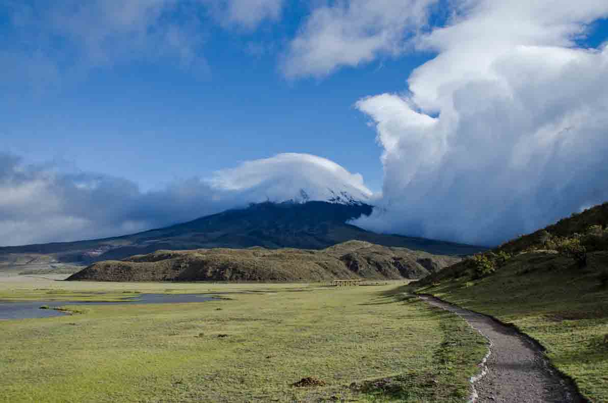 View of Cotopaxi with incoming clouds; Laguna Limpiopungo, Cotopaxi National Park, Ecuador