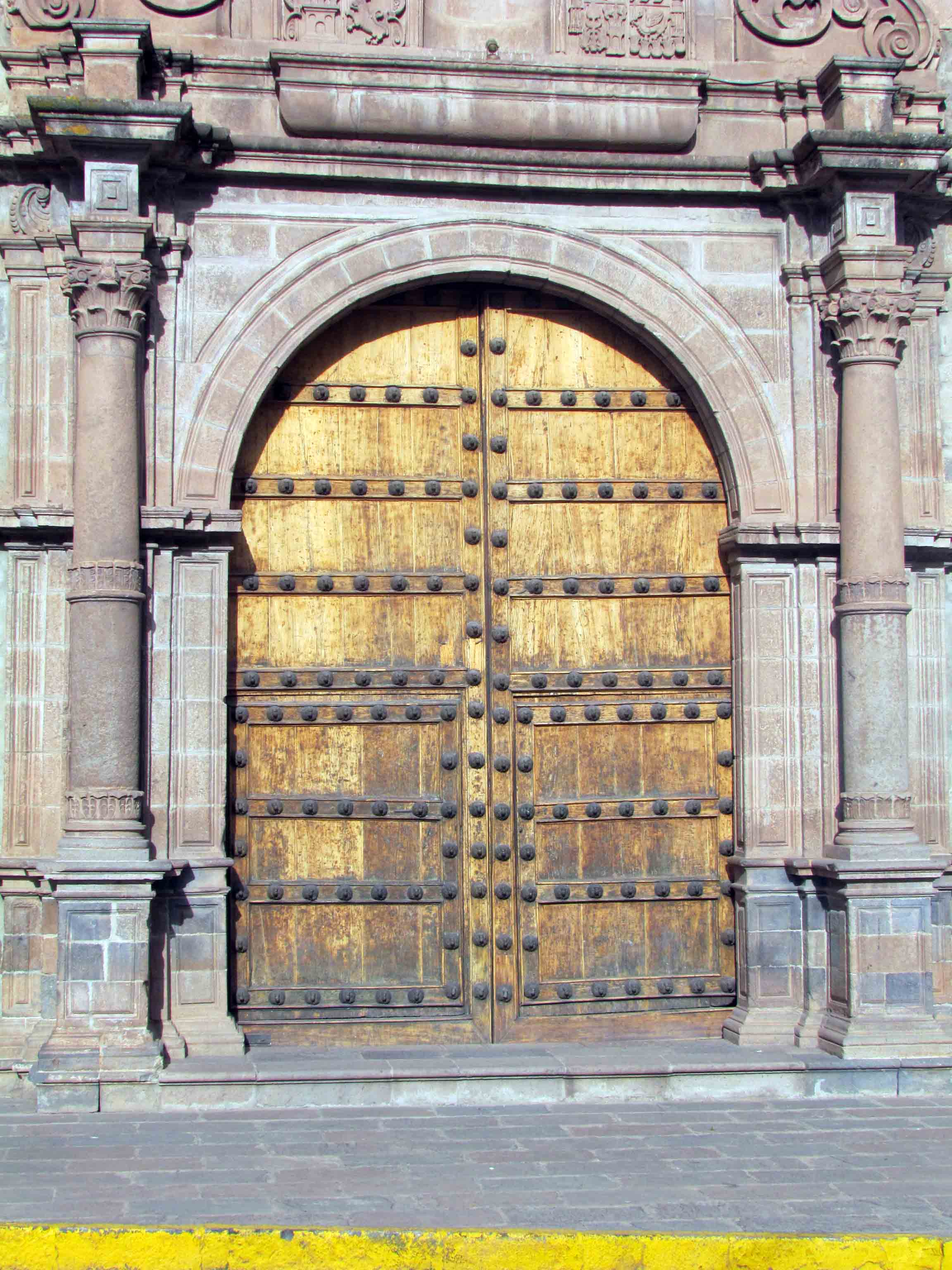 Wooden doors of a Spanish Colonial building in Cusco, Peru   ©Angela Drake