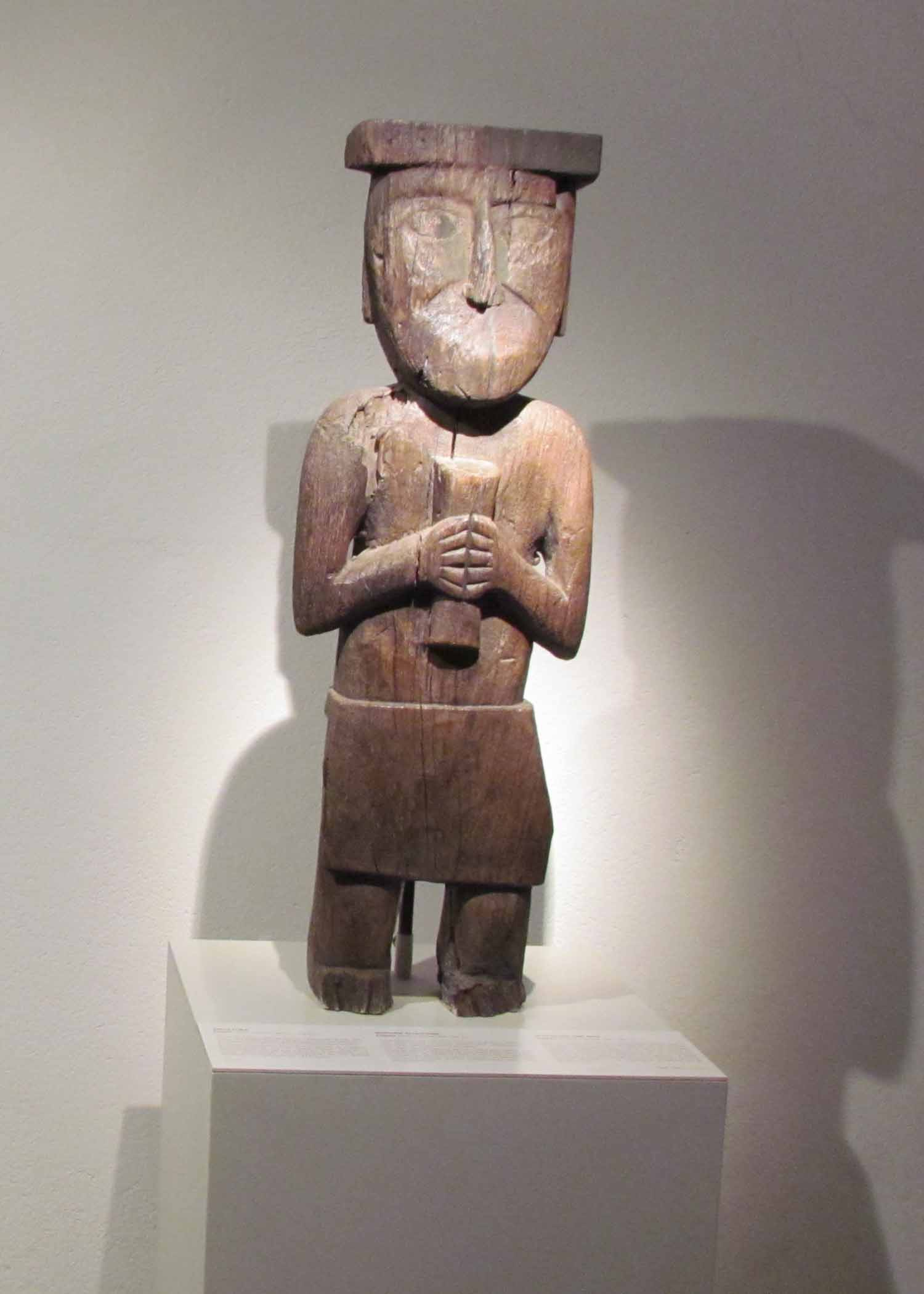 A wood carved figure on display at the Pre-Colombian Art Museum, Cusco, Peru | ©Angela Drake