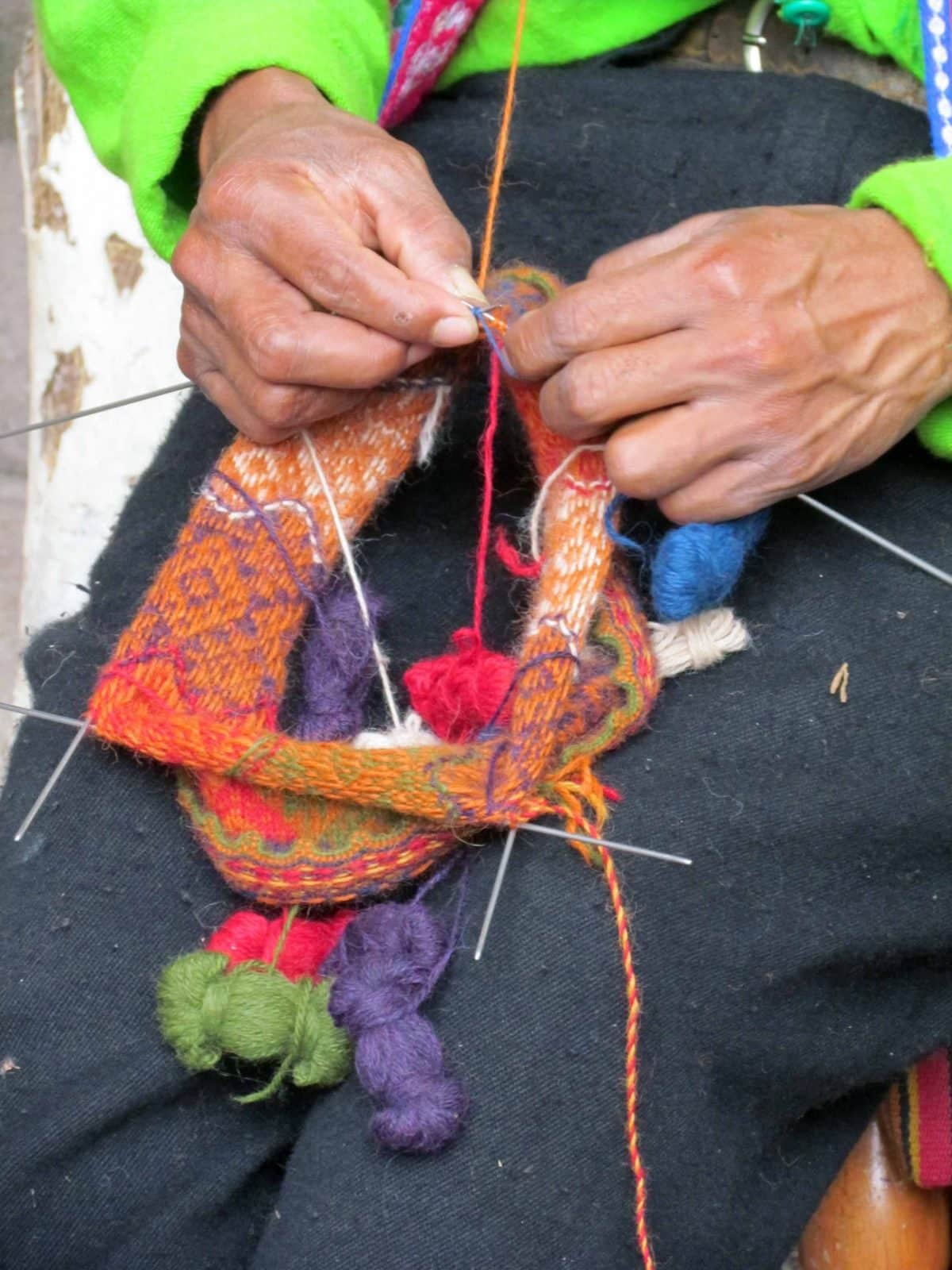 Knitting a traditional woolen hat; The Center for Traditional Textiles of Cusco, Peru | ©Angela Drake