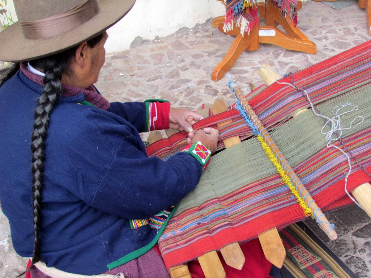 Using a backstrap loom; The Center for Traditional Textiles of Cusco, Peru | ©Angela Drake