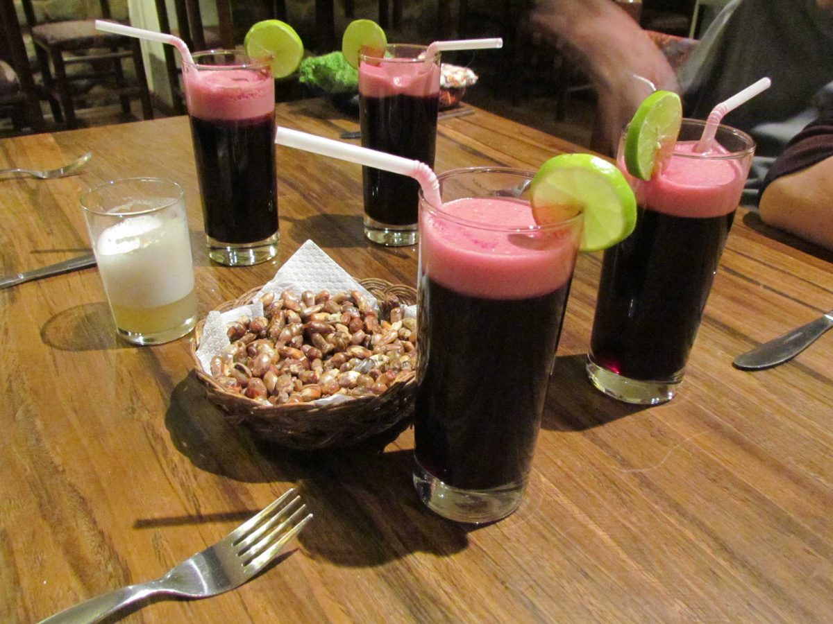 Chicha (almost empty), Chica Morada, and Cancha (toasted corn) | ©Angela Drake