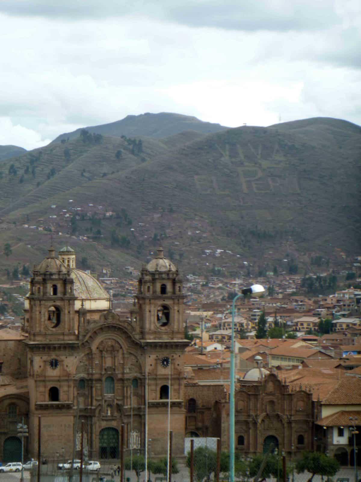 Iglesia de la Compañía with Viva El Peru hillside; Cusco, Peru | ©Angela Drake