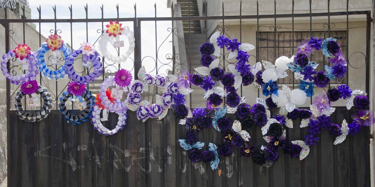 Wreaths of plastic flowers last longer than bouquets, Calderón, Quito, Ecuador | ©Angela Drake