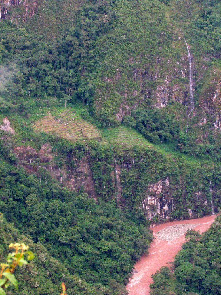 Waterfall, lower terraces of Machu Picchu, and the Rio Urubamba