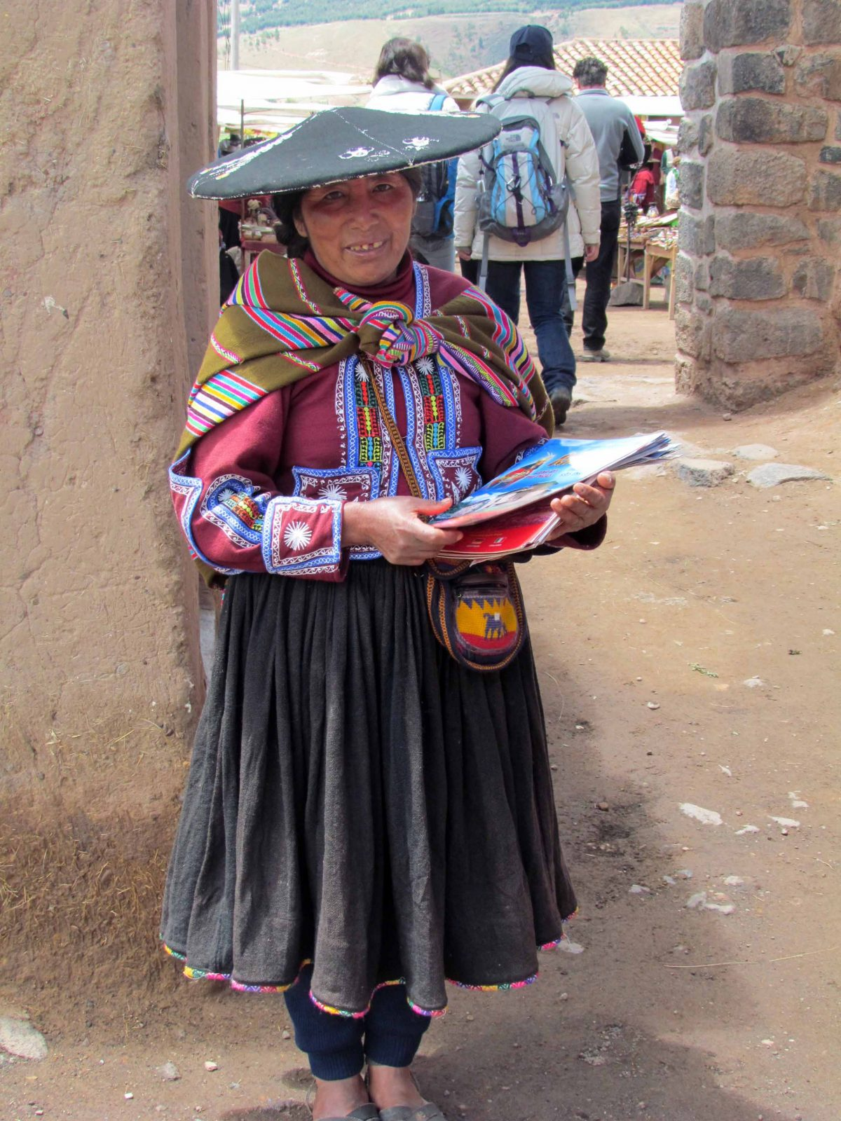 A local woman handing out tourist guides, Peru | ©Angela Drake