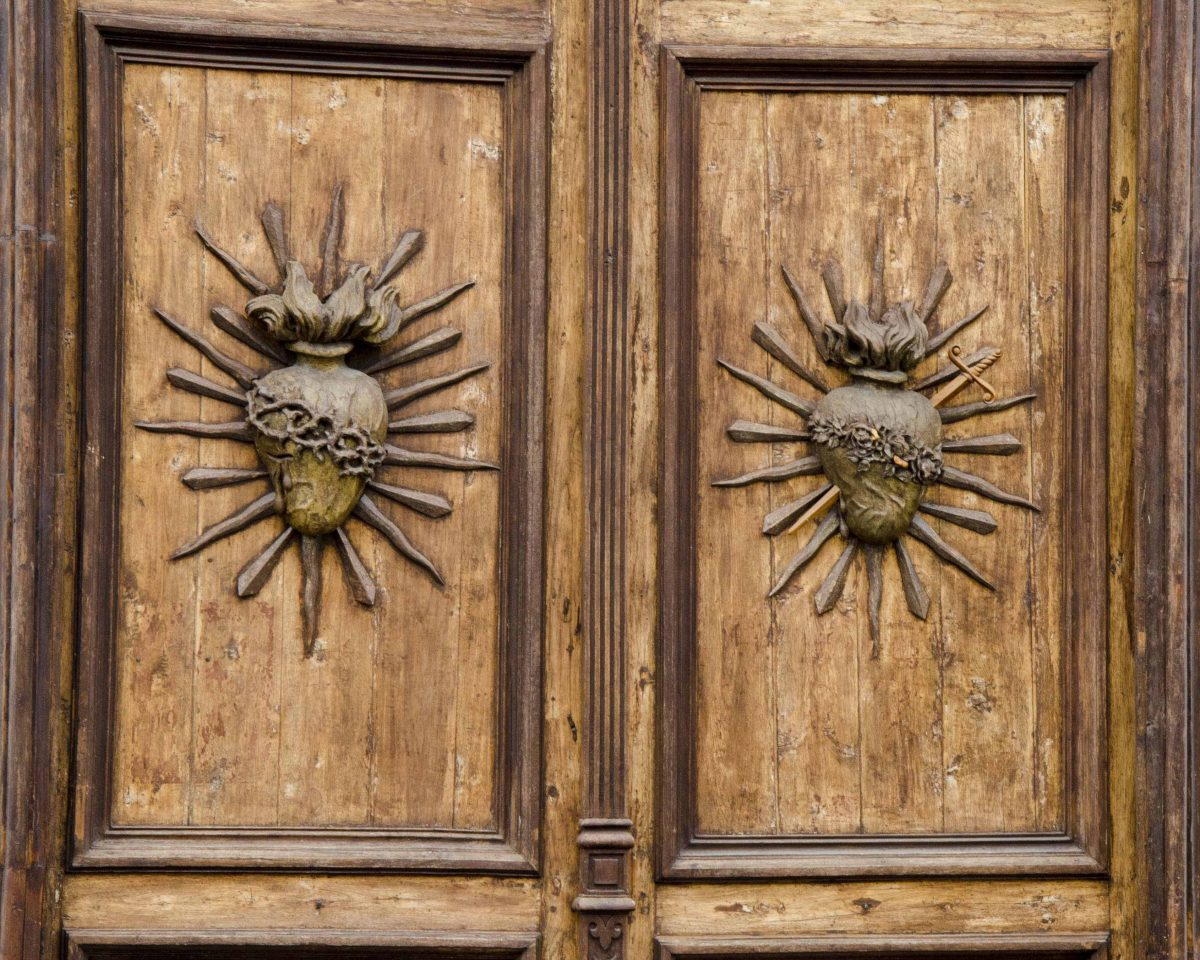 Carved wooden doors to the Iglesia de Todos Santos, Cuenca, Ecuador