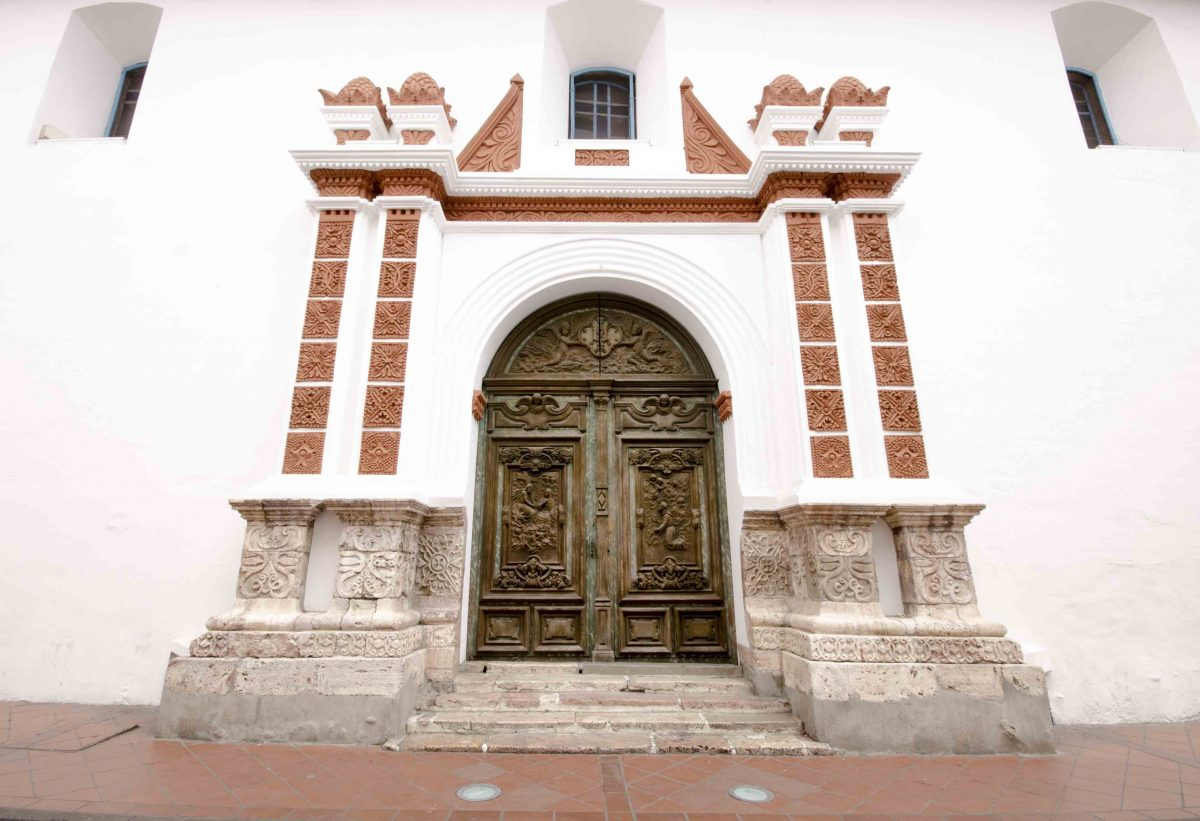 Carved wooden doors of the Iglesia de las Conceptas, Cuenca, Ecuador