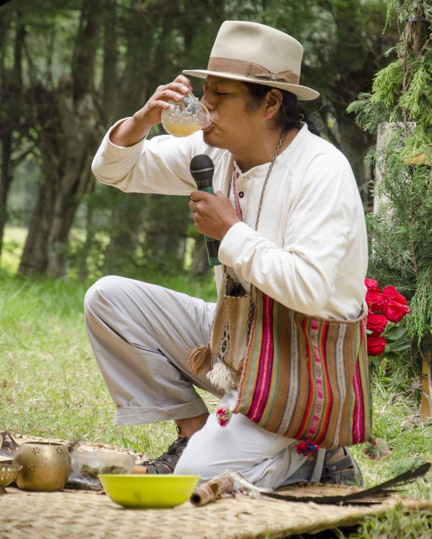 Shaman drinking Chicha de Jora, Saraguro Kapak Raymi festival near Quito.