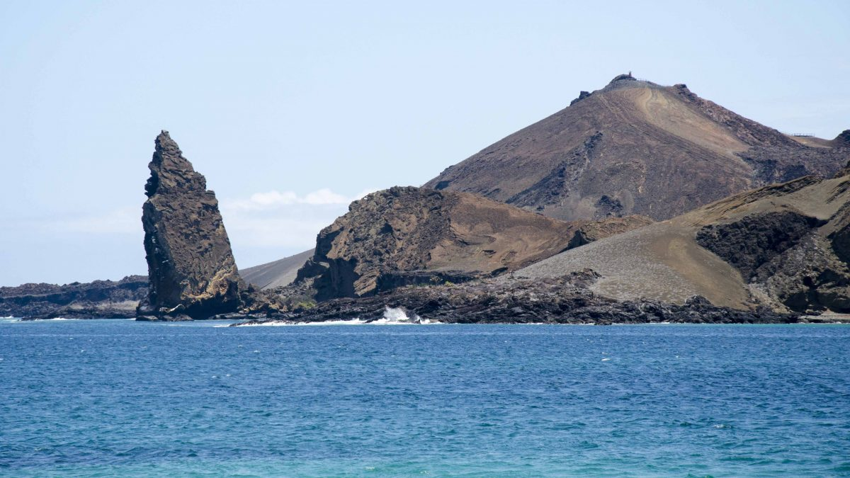 Pinnacle Rock, heading towards Bartolome from Santiago Island, the Galapagos.