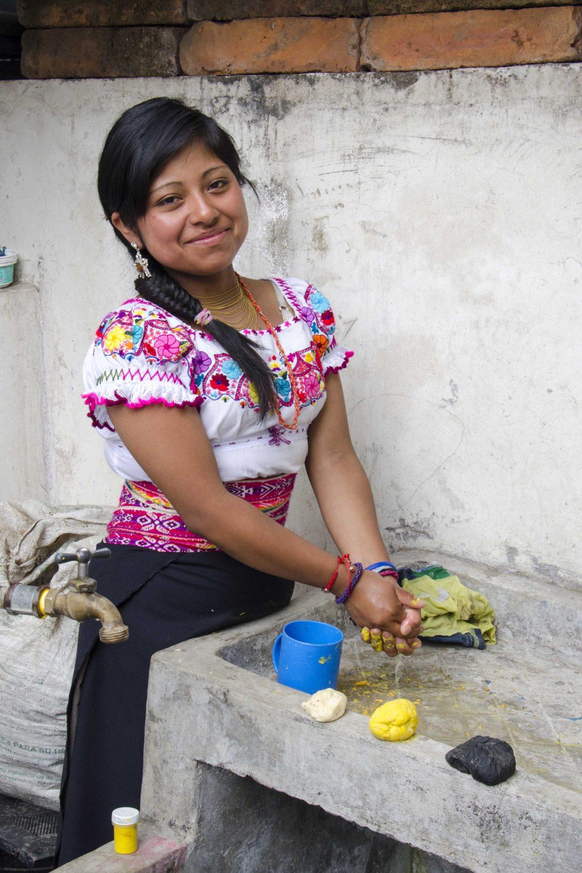 Adding dye to bread dough for Guaguas de Pan, Peguche, Ecuador | ©Angela Drake