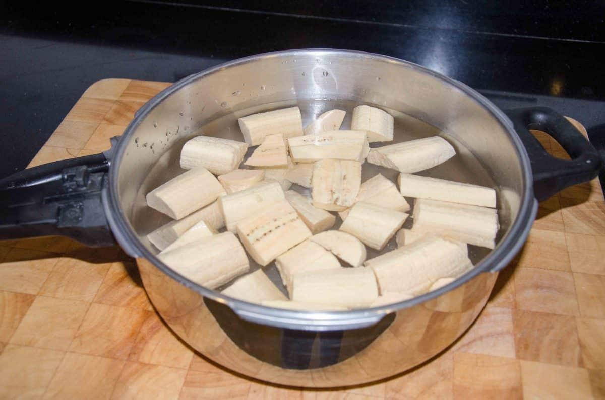 Place plantain in a pot of water; recipe for Bolón de Verde