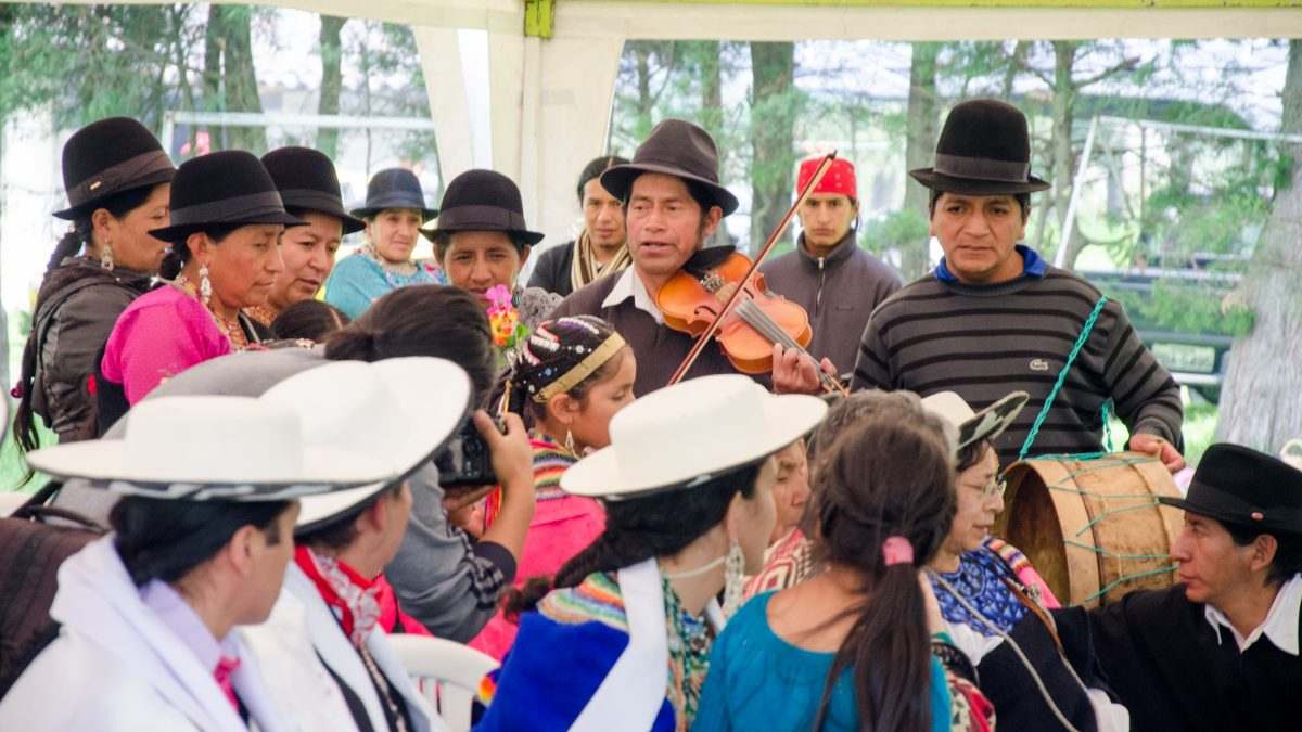 The Saraguro Council watches the band play at Kapak Raymi, Quito, Ecuador | ©Angela Drake / Not Your Average American