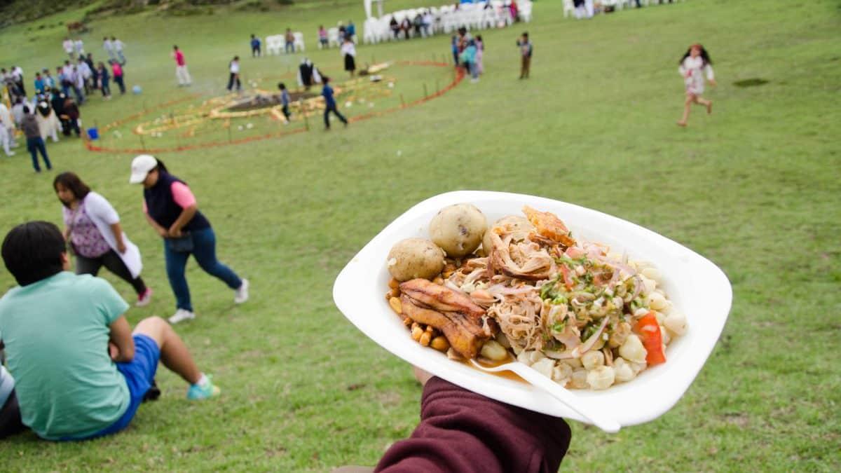 A plate of delicious hornado, Mushak Nina festival, Cochasquí, Ecuador | ©Angela Drake