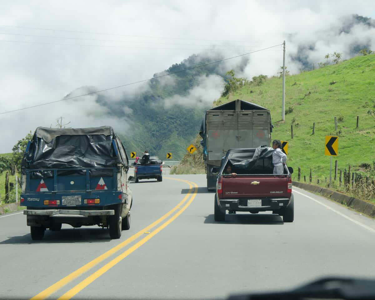 Several cars passing on a curve in Ecuador | ©Angela Drake