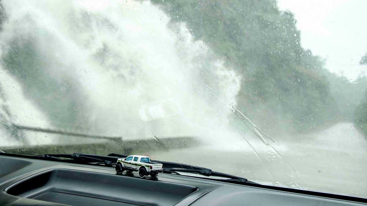 Waterfall goes over the main road from Loja to Zamora, Ecuador | ©Angela Drake