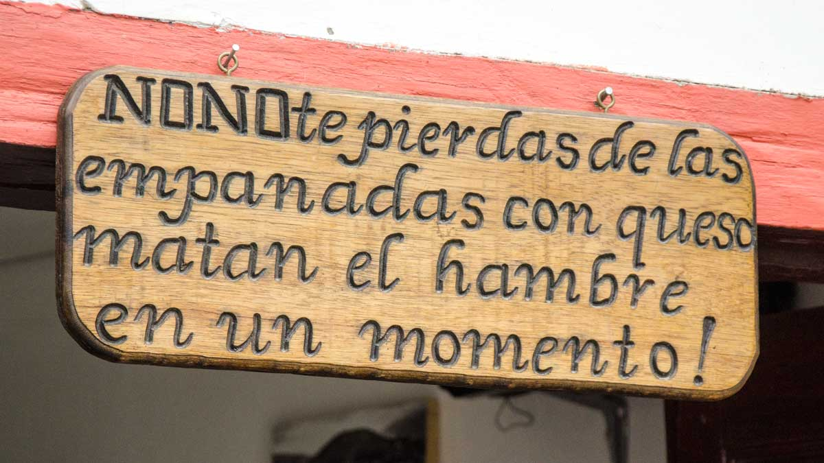 Sign outside La Casa de La Empanada, Nono, Ecuador | ©Angela Drake