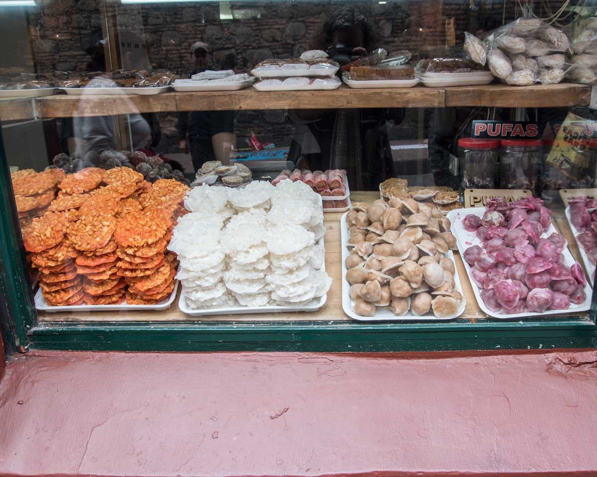 A Front Window Full of Sweets, La Puerta Falsa, Bogota | ©Angela Drake