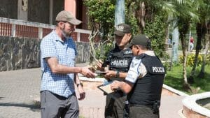 The Immigration Police check the visa extension and passport of a tourist | ©Angela Drake