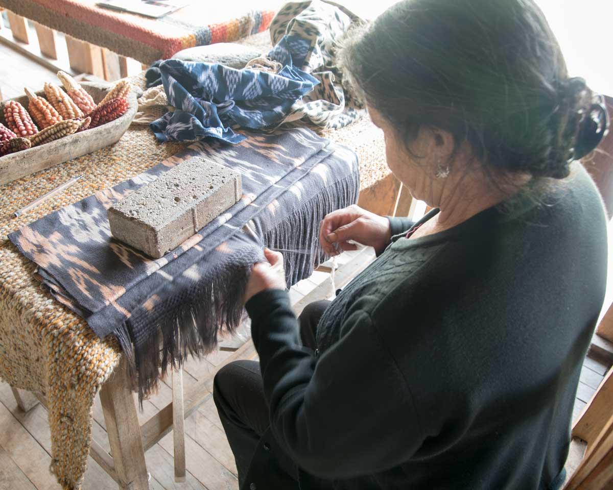 Ana María Ulloa demonstrates hand weaving; La Casa de la Macana, Gualaceo, Ecuador | ©Angela Drake