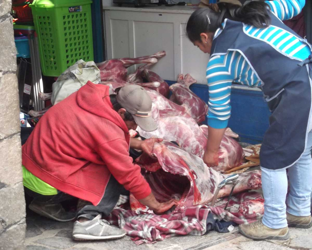 Butchers at the local market, Chivay, Peru | ©Eleanor Hughes