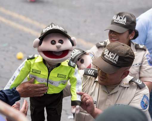 Police with Puppets; Mama Negra Parade, Latacunga, Ecuador   ©Angela Drake