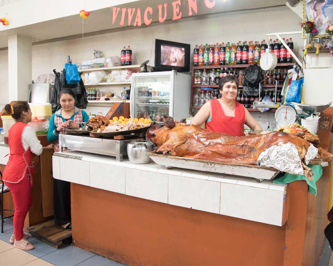 Hornado Stall in downtown market, Cuenca, Ecuador | ©Angela Drake