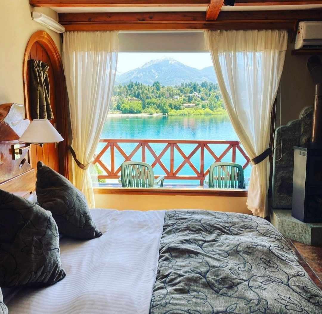 Double bed in room with view of Lake Nahuel Huapi